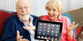 Elder couple holding IPad